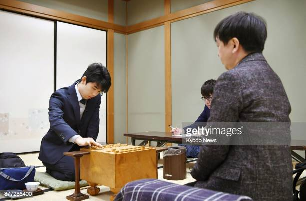 Fifteenyearold Sota Fujii Japan' youngest professional shogi player competes against 54yearold Shingo Hirafuji in Osaka on Nov 21 2017 Fujii clinched...