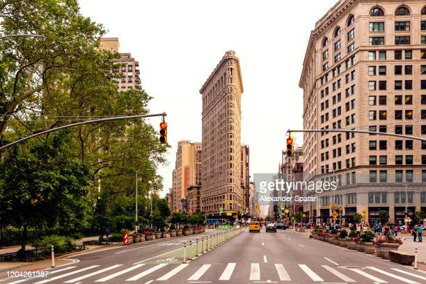 fifth avenue and flatiron building at manhattan, new york city, usa - broadway manhattan stock pictures, royalty-free photos & images
