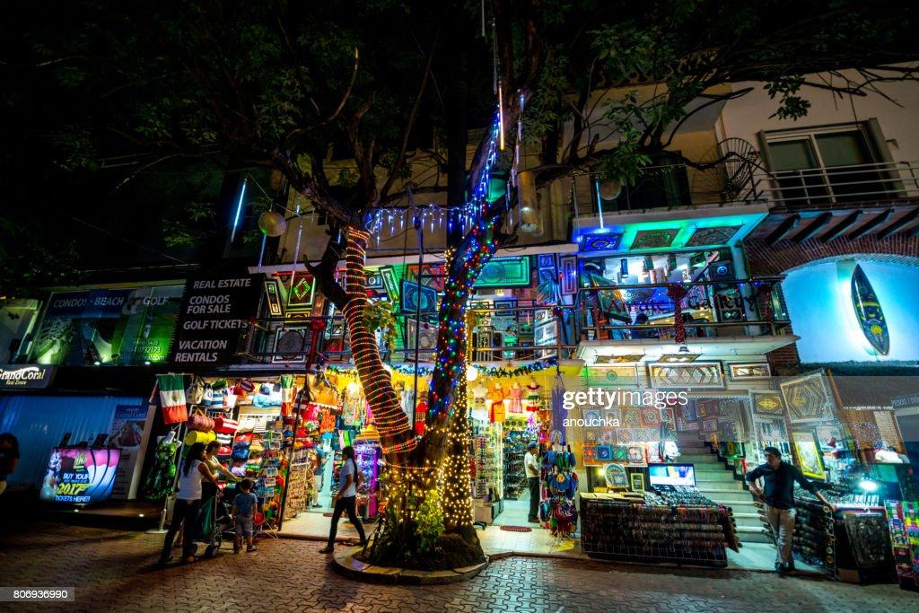 Fifth Avenue, famous shopping street on Playa del Carmen, illuminated at night : Stock Photo