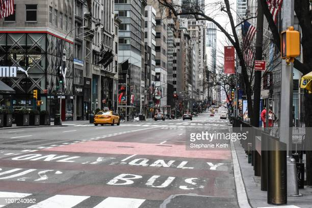 Fifth Avenue in Midtown Manhattan is mostly clear of traffic on March 15, 2020 in New York City. The World Health Organization declared COVID-19 a...