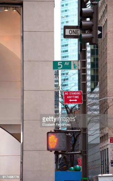 Fifth Avenue, multiple street signs