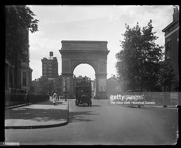 Fifth Avenue near 8th Street looking south towards Washington Square Arch with pedestrians and double decker bus New York New York early 1920s