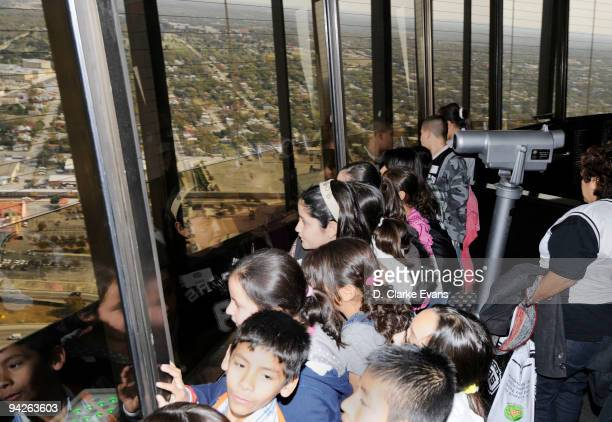 Fifth grade students from Goodwin Frazier Elementary School that won the Tony Parker Around the World Essay Contest take look out at the view from...
