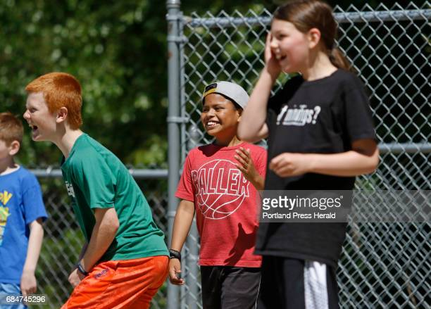 Fifth grader Luis Wood center has some fun playing kickball during Field Day at Manchester Elementary School in Windham