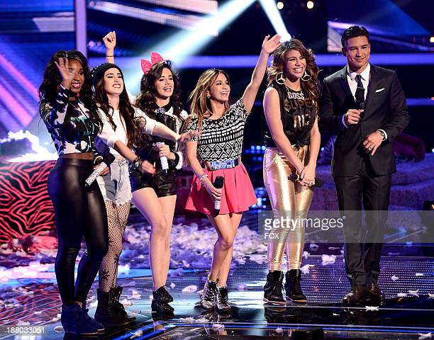 Fifth Harmony and host Mario Lopez on FOX's 'The X Factor' Season 3 Top 12 To 10 Live Elimination Show on November 14 2013 in Hollywood California