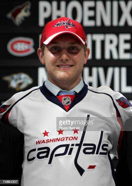 Fifth overall pick Karl Alzner of the Washington Capitals poses after being drafted in the first round of the 2007 NHL Entry Draft at Nationwide...