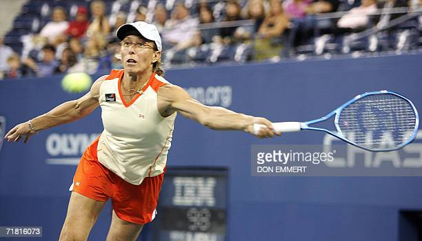 Fifth seeded Martina Navratilova of the US, paired with Bob Bryan of the US, returns the ball to Anna-Lena Groenfeld of Germany and Frantisek Cermak...