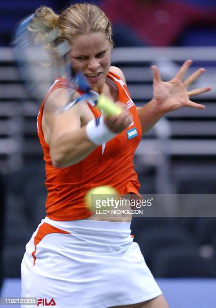 Fifth-seeded Belgian player Kim Clijsters returns a shot during her first round elimination match against US player Chandra Rubin at the WTA Tennis...