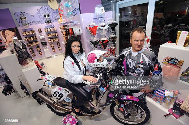 Fifth-time Paris-Dakar moto competitor, French amator Hugo Payen , poses in a Dorcelstore on November 19, 2011 in Saint-Herblain near the western...