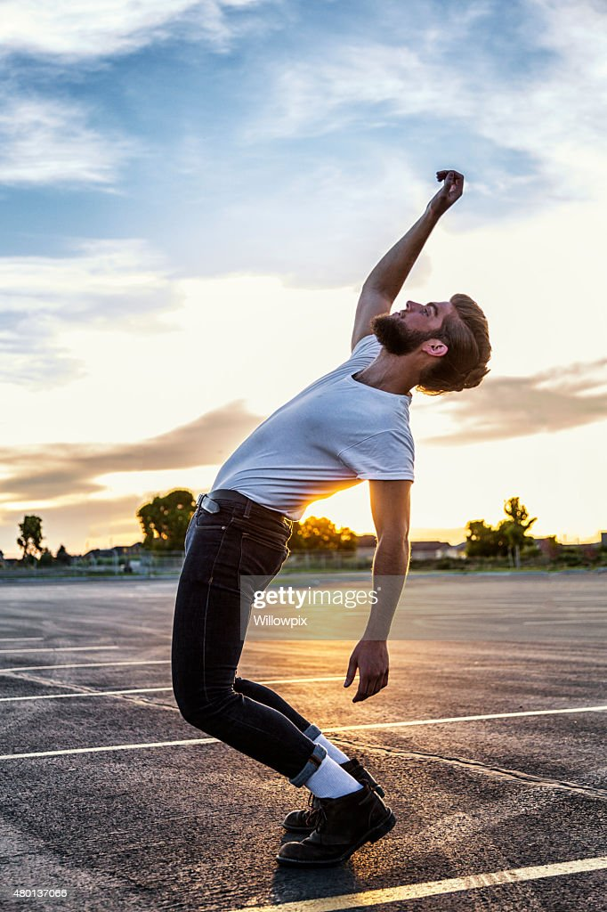 Fifties Greaser Bending Backwards in Sunset : Stock Photo