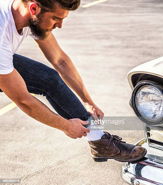 Fifties Greaser Guy Adjusting Tight Jeans