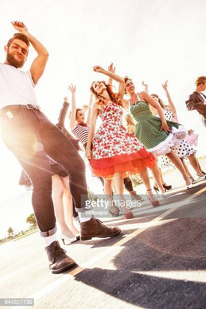 fifties high school graduation dance sun flare dancers - men in white socks stock photos and pictures