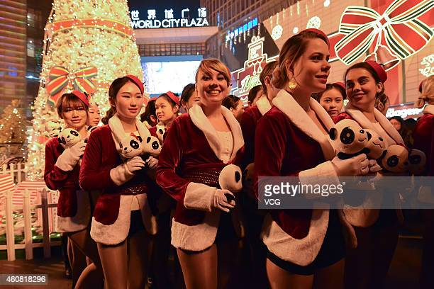Fifty Chinese and foreign beauties wearing the Christmas costume parade at the street during Christmas eve on December 24 2014 in Wuhan Hubei...