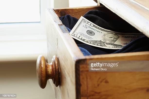 Fifty dollar bill in hidden in sock draw