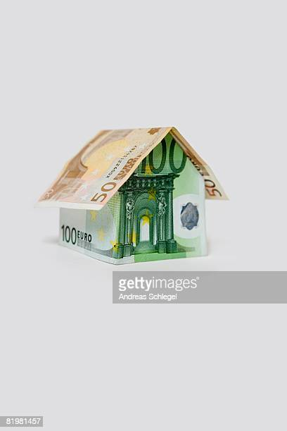 A Fifty Euro Banknote and a Hundred Euro Banknote folded to look like a house