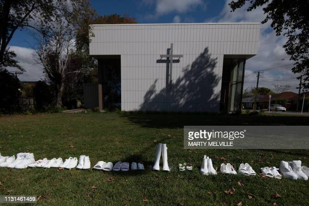 Fifty pairs of shoes lay outside the All Souls Church representing the 50 people gunned down at the two mosques in Christchurch on March 19 2019 The...