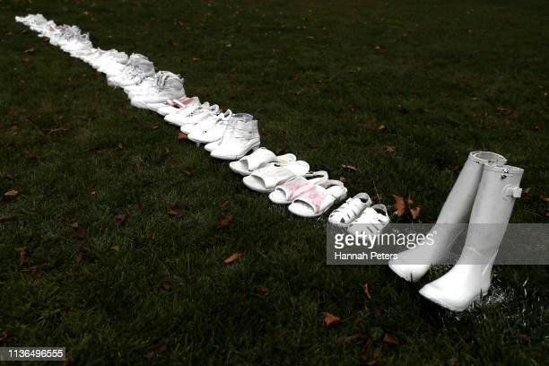 Fifty pairs of white shoes have been laid in front of All Souls Anglican Church in honour of victims who lost their lives on March 18, 2019 in...
