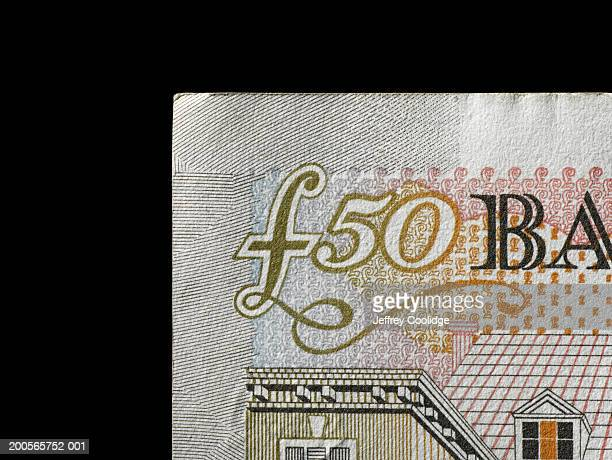 fifty pound note against black background, close-up - fifty pound note stock pictures, royalty-free photos & images