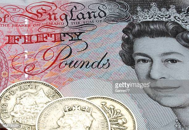 Fifty Pound note and coins