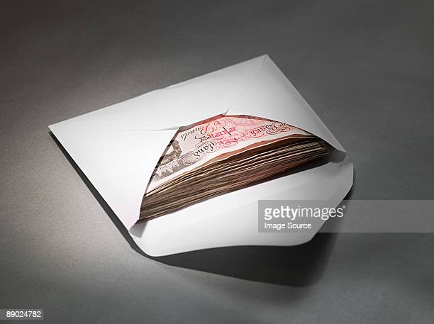 Fifty pound notes in an envelope