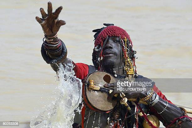 Fifty Sevenyearold herbalist Musa Bawasa entertains guests from the Argungu River during the Argungu fishing festival at Argungu Kebbi State in...