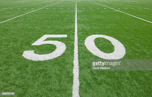 fifty yard line on american football field - number 50 stock pictures, royalty-free photos & images