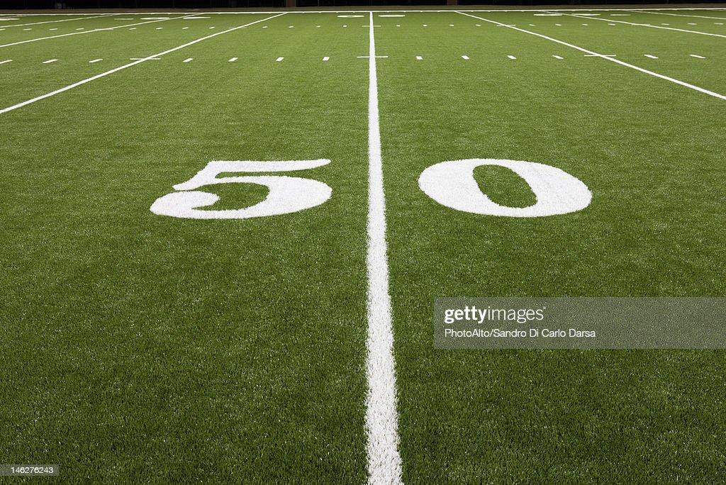 Fifty yard line on football field : Stock Photo