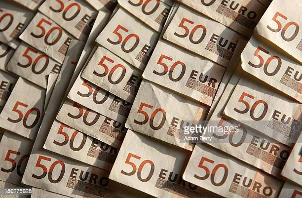 Fiftyeuro notes lie on a table for a photo illustration on November 12 2012 in Berlin Germany The euro fell against the dollar on Friday to its...
