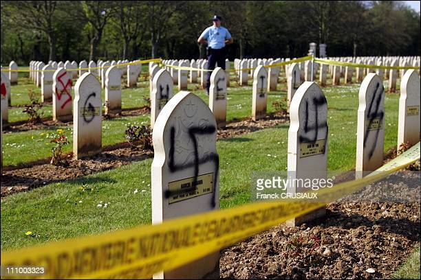 Fiftytwo graves of the Muslim cemetery military NotreDamedeLorette near Arras were covered with inscriptions Nazi Swastikas and Celtic were painted...