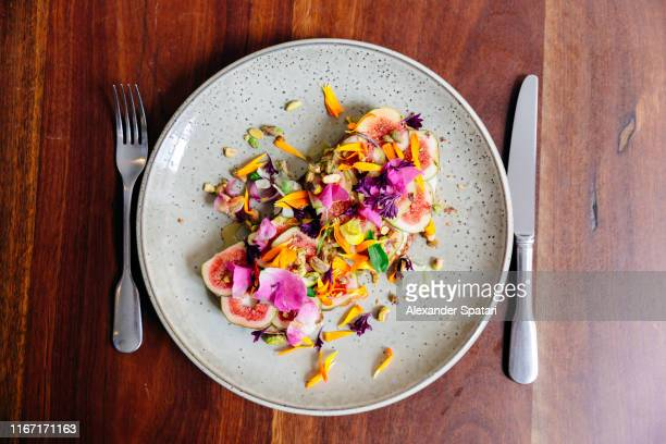 fig toast with mascarpone cheese, pistachio and edible flowers - mascarpone cheese stock pictures, royalty-free photos & images