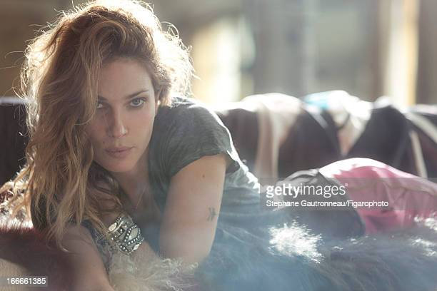 Figaro ID 101510005 Model Erin Wasson poses for Madame Figaro on July 8 2011 in Paris France Tshirt pants earrings personal jewelry On the sofa...