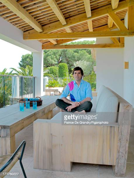 Figaro ID: 104642-003. Architect Pierre Yovanovitch is photographed for Madame Figaro on May 1, 2013 in St Tropez, France. Yovanovitch sits on a...