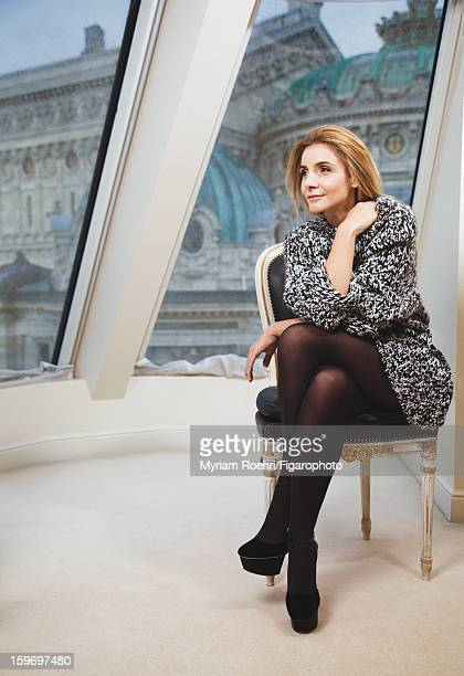 Figaro ID 105119008 Actress Clotilde Courau is photographed for Madame Figaro on October 8 2012 in Paris France Sweater by Giambattista Valli tights...