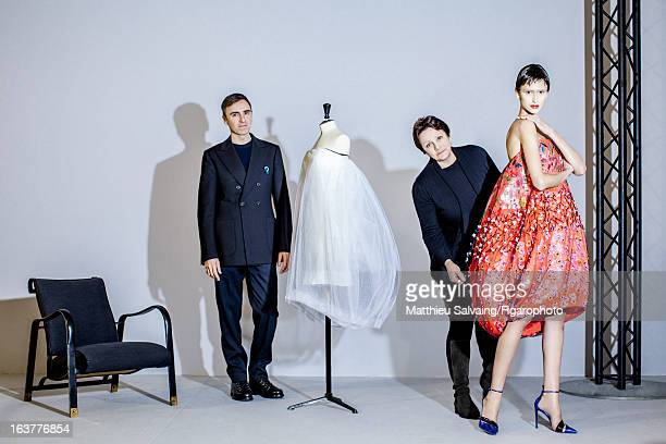 Figaro ID 105895005 Fashion designer Raf Simons for Dior and Florence Chenet are photographed with dresses from the 2013 spring/summer haute couture...