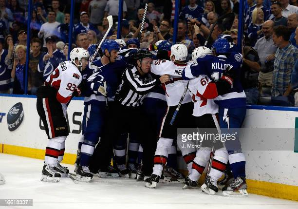 A fight between the Tampa Bay Lightning and the Ottawa Senators breaks out as time expires at the Tampa Bay Times Forum on April 9 2013 in Tampa...