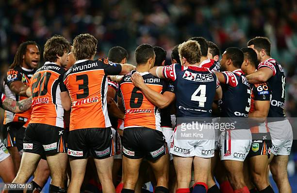 A fight break out after an altercation between Luke O'Donnell of the Roosters and Keith Galloway of the Tigers during the round 23 NRL match between...