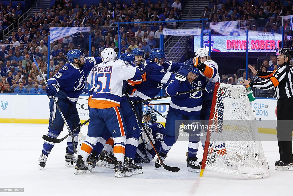 A fight breaks out a top of Ben Bishop #30 of the Tampa Bay Lightning during the first period in Game Two of the Eastern Conference Second Round during the 2016 NHL Stanley Cup Playoffs at Amalie Arena on April 30, 2016 in Tampa, Florida.