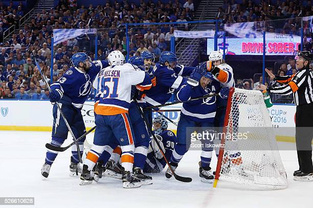 A fight breaks out a top of Ben Bishop of the Tampa Bay Lightning during the first period in Game Two of the Eastern Conference Second Round during...
