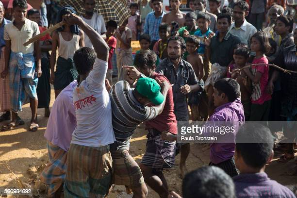 A fight breaks out as Rohingya gets frustrated after waiting hours in the hot sun in line for humanitarian aid on October 13 2017 in Kutuplaong Cox's...