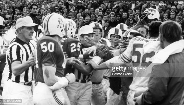 A fight breaks out between Boston Patriot and Buffalo Bill players during a game at Alumni Stadium in Chestnut Hill Mass on Nov 23 1969