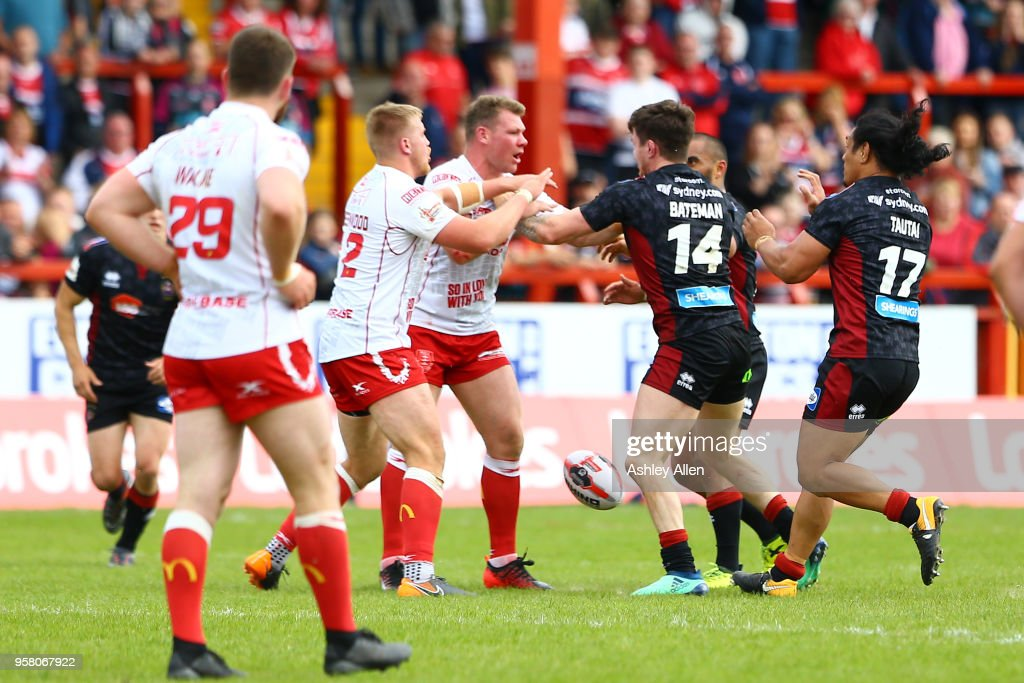 A fight breaks out between players of Hull KR and Wigan Warriors during round six of the Ladbrokes Challenge Cup at KCOM Craven Park on May 13, 2018 in Hull, England.