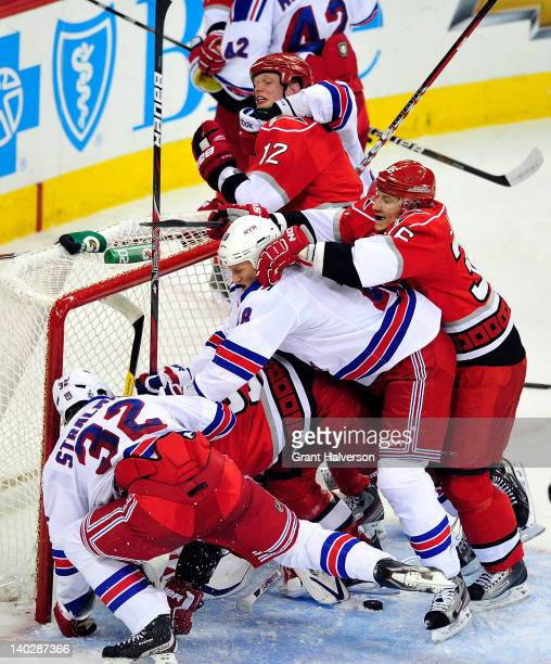 A fight breaks out between the New York Rangers and the Carolina Hurricanes in front of the New York net during play at the RBC Center on March 1...
