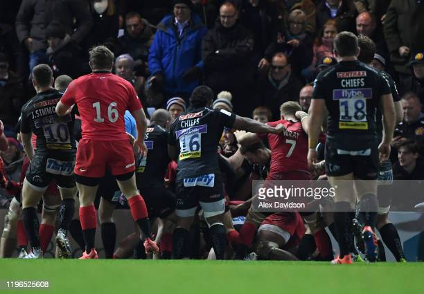 Fight breaks out during the Gallagher Premiership Rugby match between Exeter Chiefs and Saracens at Sandy Park Stadium on December 29, 2019 in...