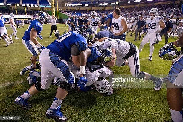 Fight breaks out on the field after the game between the Brigham Young Cougars and the Memphis Tigers at Marlins Park on December 22, 2014 in Miami,...