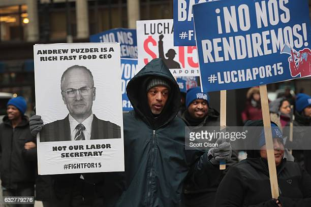 Fight for $15 workers protest the nomination of Andy Puzder for labor secretary on January 26 2017 in Chicago Illinois Puzder is currently chief...