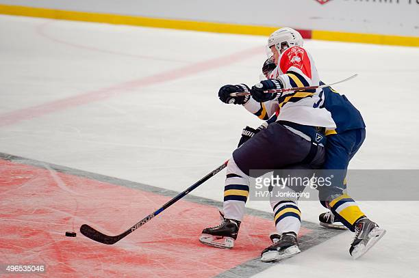 Fight for the puck during the Champions Hockey League round of eight game between HV71 Jonkoping and Espoo Blues on November 10, 2015 in Jonkoping,...