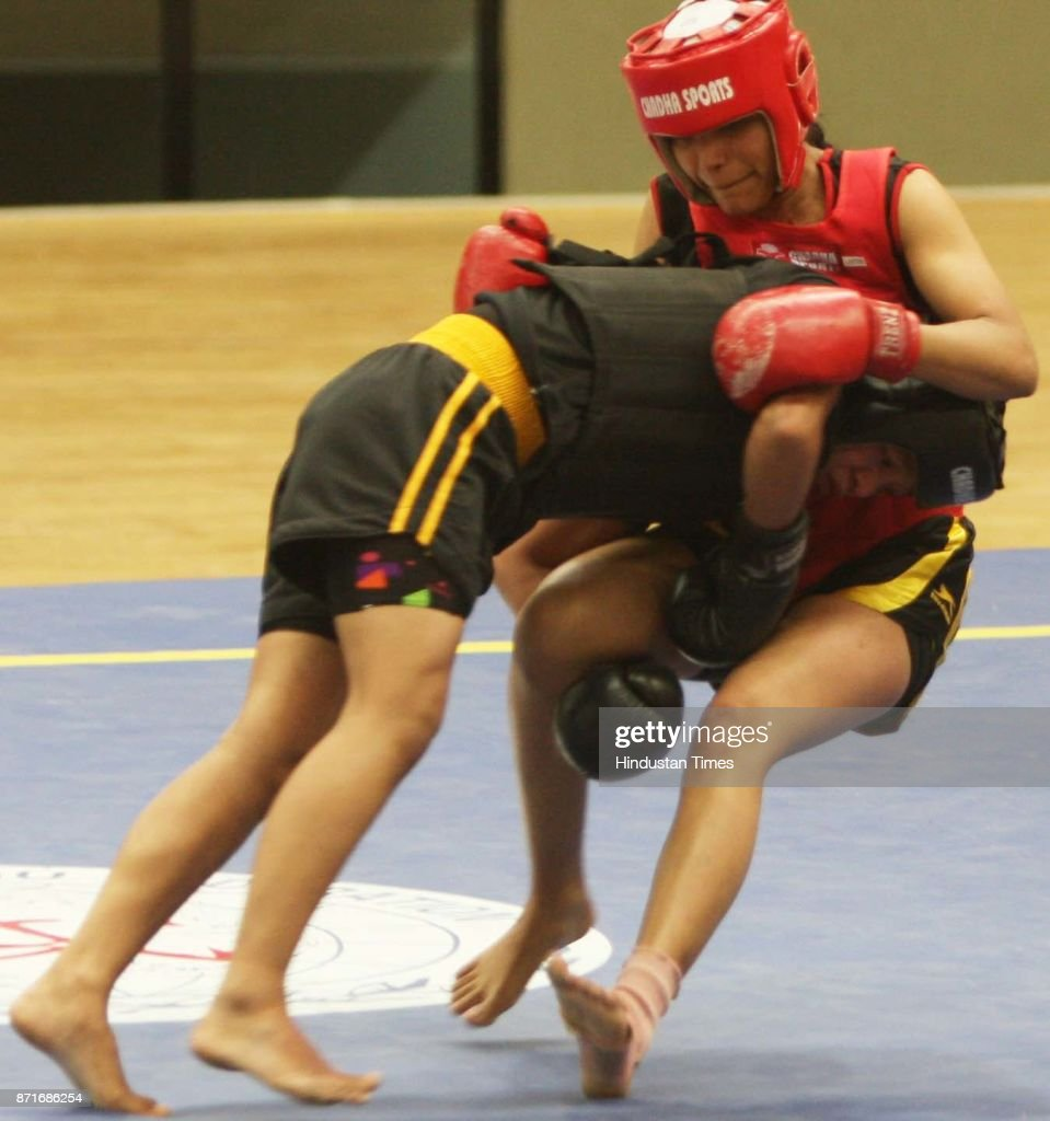 A fight in progress between Jharkhand and Punjab during the Wushu championship at 34th National Games at Thakur Viswanath Shadeo Indoor Stadium in...