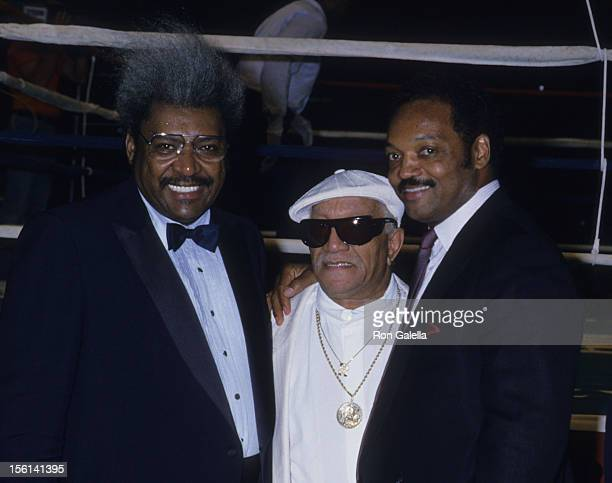 Fight Promoter Don King actor Red Foxx and Jesse Jackson attend Mike Tyson vs Michael Spinks Boxing Match on June 27 1988 at the Trump Plaza in...