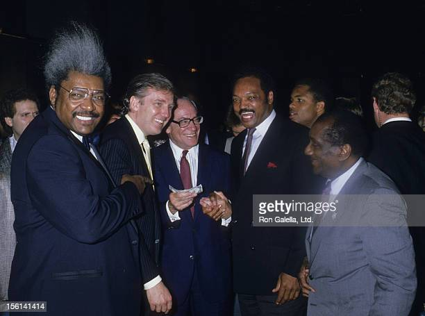 Fight Promoter Don King businessmen Donald Trump and Malcolm Forbes Jesse Jackson and John H Johnson attend Mike Tyson vs Michael Spinks Boxing Match...