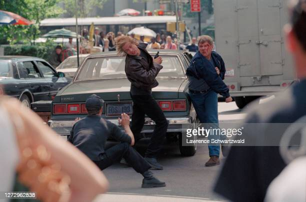 Fight scene between Harrison Ford and Brad Pitt on the shooting of Devil's ownby Alan Pakula